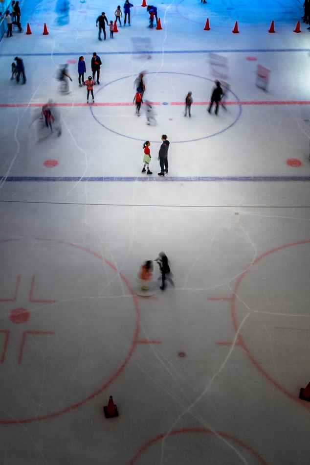 time lapse photography of people ice skating